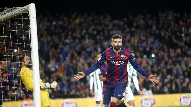 Barcelona's Pique celebrates a goal against Cordoba during their Spanish First division soccer match in Barcelona