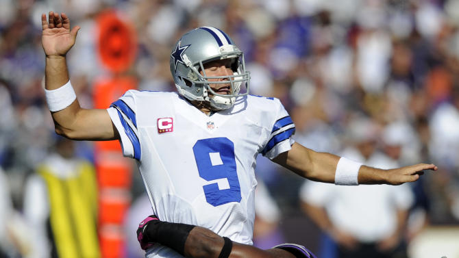 Dallas Cowboys quarterback Tony Romo reacts as he is tackled by Baltimore Ravens outside linebacker Courtney Upshaw in the second half of an NFL football game in Baltimore, Sunday, Oct. 14, 2012. (AP Photo/Nick Wass)