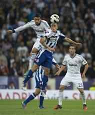 Real Madrid's Cristiano Ronaldo (L) and Deportivo's Alex Bergantinos during their Spanish League match on September 30. With Madrid controlling the game Pepe headed home and Ronaldo scored another penalty in the second half to complete the rout