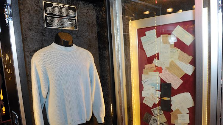 "A sweater worn by Buddy Holly during his 1958 tour of England along with Tommy Allsup's wallet, right, which was recovered from the wreckage of the Buddy Holly plane crash, are on display at Hard Rock International's traveling music memorabilia tour, ""Gone Too Soon,"" at Hard Rock Cafe New York, Wednesday, Feb. 13, 2013. ""Gone Too Soon"" pays tribute to music icons whose lives and career where tragically cut short and will be on tour at Hard Rock locations in the U.S. throughout 2013. (Photo by Diane Bondareff/Invision for Hard Rock International/AP Images)"