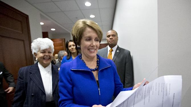 House Minority Leader Nancy Pelosi of Calif., followed by Rep. Grace Napolitano, D-Calif., and others, emerges from a closed caucus meeting on Capitol Hill in Washington, Wednesday, Nov. 14, 2012. to announce that she wants to remain as the top Democrat in the House of Representatives.  (AP Photo/J. Scott Applewhite)