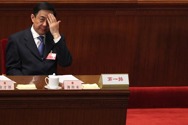 Bo Xilai, secretary of the Chinese Communist Party's Chongqing branch, saw his political career unravel in February after a police official implicated him and his wife in the murder of a family associate. (Feng Li/Getty Images)