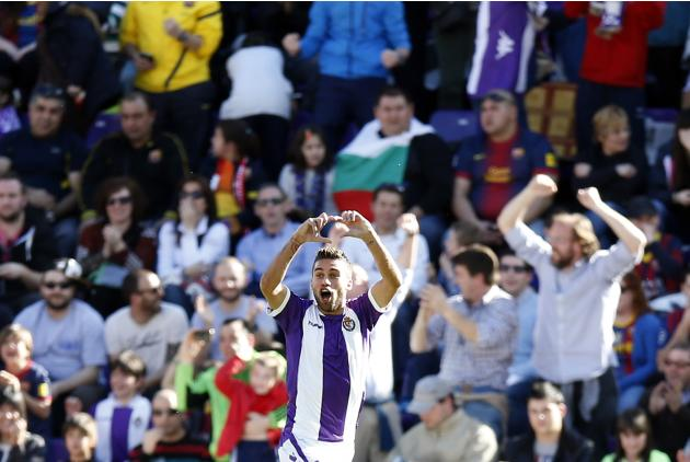 Valladolid's Rossi celebrates after scoring a goal against Barcelona during their Spanish first division soccer match in Valladolid