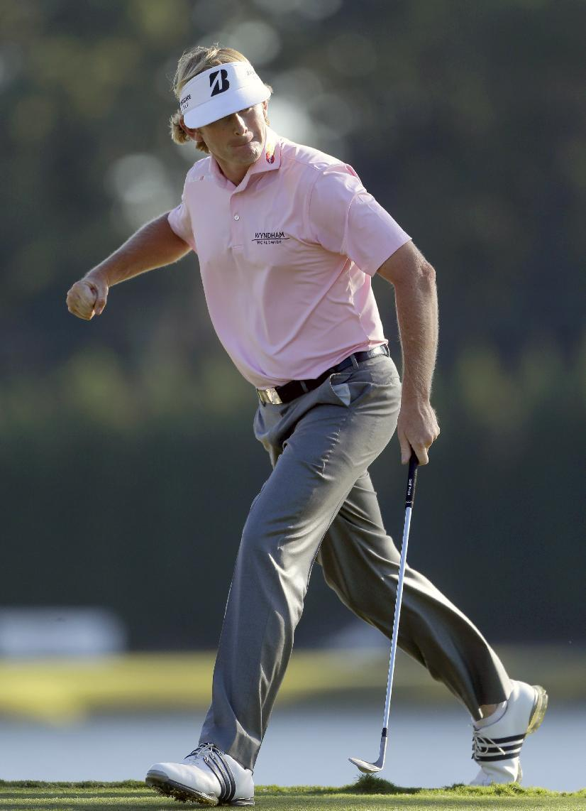 Brandt Snedeker reacts after sinking his putt on the 17th hole during the final round of the Tour Championship golf tournament on Sunday, Sept. 23, 2012, in Atlanta. (AP Photo/John Bazemore)