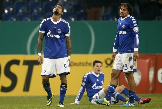 Schalke 04's Boateng, Draxler and Jones react after their third round German soccer cup (DFB-Pokal) match in Gelsenkirchen