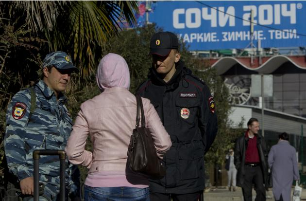 Russian police check a passerby in Sochi