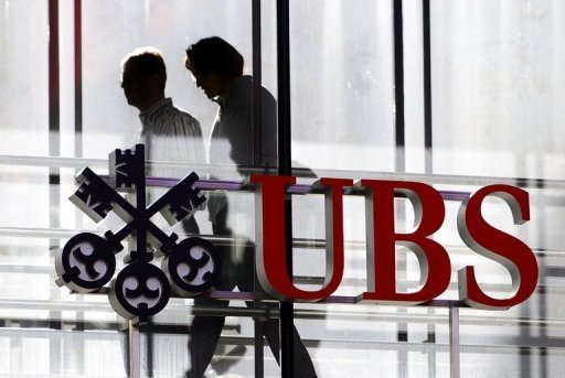 &lt;p&gt;Employees walk past a logo of the Swiss banking giant UBS on October 30, 2012 in Zurich. The bank has been slapped with $1.5 billion in fines for manipulating global interest rates, also tampered with Swiss franc interest rates for more than a decade, a Swiss newspaper reported Sunday.&lt;/p&gt;