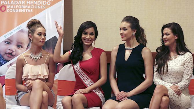Miss Universe Canada 2015 Nunez Valdez waves next to other finalists in the competition McKay, Heinsar and Kohut during a news conference in Managua, Nicaragua