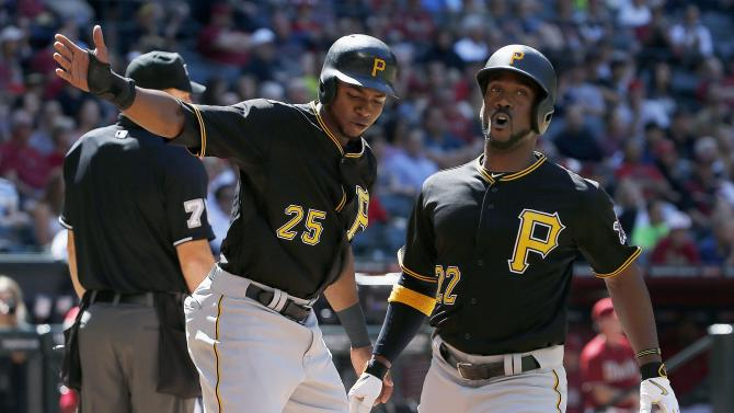 Pittsburgh Pirates' Andrew McCutchen (22) shouts as he celebrates with Gregory Polanco (25) after both scored on a two-run double by Neil Walker during the fifth inning of a baseball game against the Arizona Diamondbacks Sunday, April 26, 2015, in Phoenix. (AP Photo/Ross D. Franklin)