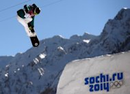 Torah Bright competes in the Women's Snowboard Slopestyle qualification at the Rosa Khutor Extreme Park during the Sochi Winter Olympics on February 6, 2014