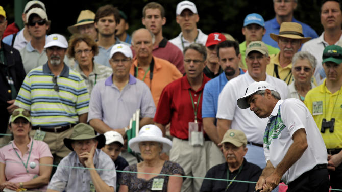 Fred Couples takes a shot on the first hole during the second round of the Masters golf tournament Friday, April 12, 2013, in Augusta, Ga. (AP Photo/David J. Phillip)
