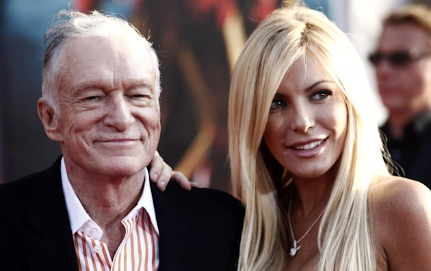 FILE - In this April 26, 2010 file photo, Hugh Hefner, left, and Crystal Harris arrive at the premiere of &quot;Iron Man 2&quot; at the El Capitan Theatre in Los Angeles. Hefner and Harris obtained a marriage license in Beverly Hills, Calif. on Tuesday Dec. 4, 2012, roughly a year-and-a-half after the centerfold called off the couple&#39;s previous engagement. (AP Photo/Matt Sayles, File)
