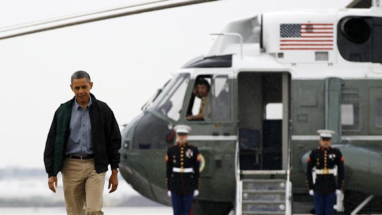 President Barack Obama walks from Marine One to board Air Force One at O'Hare International Airport in Chicago, Monday, Aug. 13, 2012 en route to Offutt Air Force Base in Bellevue, Neb., and onto a three day campaign bus tour through Iowa. (AP Photo/Carolyn Kaster)