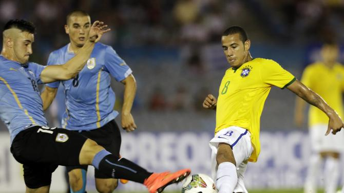 Brazil's Lucas is challenged by Uruguay's Erik Cabaco during their soccer match for the final round of the South American Under-20 Championship in Montevideo