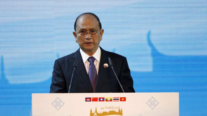 Myanmar's President Thein Sein speaks during the opening ceremony of the 5th Greater Mekong Subregion (GMS) Summit at a hotel in Bangkok