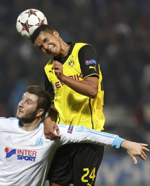 Olympique Marseille's Gignac challenges Borussia Dortmund's Sarr during their Champions League soccer match in Marseille