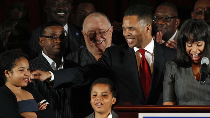 FILE - In this March 20, 2012 file photo, U.S. Rep. Jesse Jackson Jr., D-Ill., his wife Chicago Alderman Sandi Jackson, and their children Jessica, 12, and Jesse III, 8, thank supporters after his primary election win over challenger, former Rep. Debbie Halvorson in Illinois' 2nd District. When Jackson disappeared on a mysterious medical leave in June 2012, it took weeks for anyone in Washington to notice. Jackson has never lived up to the high expectations on the national stage. But none of that seems to matter in his district, where he's brought home close to $1 billion in earmarks and other funding and won every election since 1995 in a landslide, despite nagging ethical questions over links to imprisoned former Gov. Rod Blagojevich. The dual roles could help explain why the Democrat has given so few details of his medical leave. (AP Photo/M. Spencer Green, File)