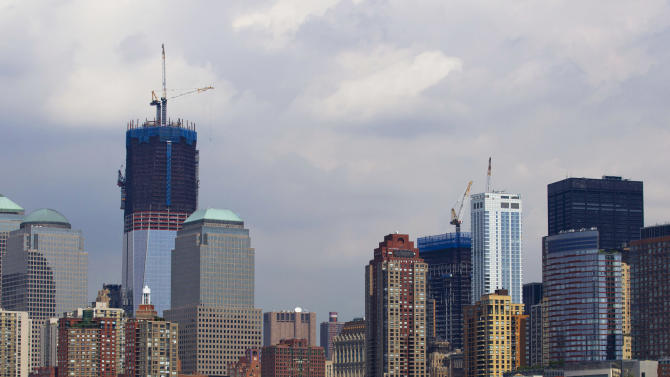 One World Trade Center rises above neighboring buildings in Lower Manhattan, as seen from New York harbor Friday, Aug. 26, 2011. Mayor Michael Bloomberg ordered the mandatory evacuation of more than 300,000 city residents who live near the waterfront in preparation for the arrival of Hurricane Irene. (AP Photo/Jin Lee)