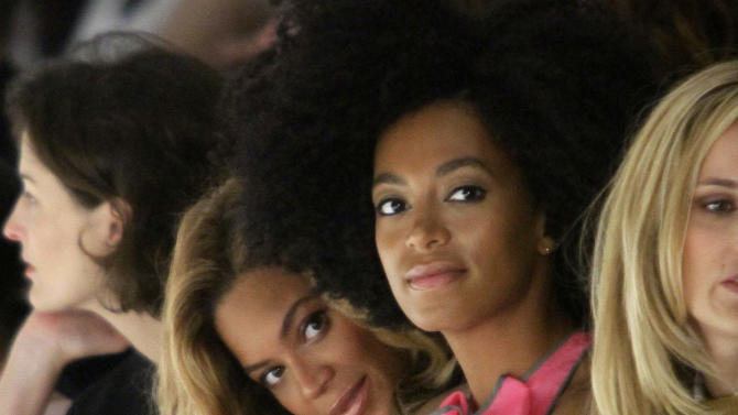 Beyonce Knowles, center left, sits with her sister Solange Knowles during the presentation of Vera Wang's  Spring 2012 collection on Tuesday, Sept. 13, 2011 in New York.  (AP Photo/Bebeto Matthews)