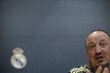 "Real Madrid's coach Benitez gestures during a news conference a day ahead of their ""Clasico"" soccer match against Barcelona at the Valdebebas training grounds outside Madrid"