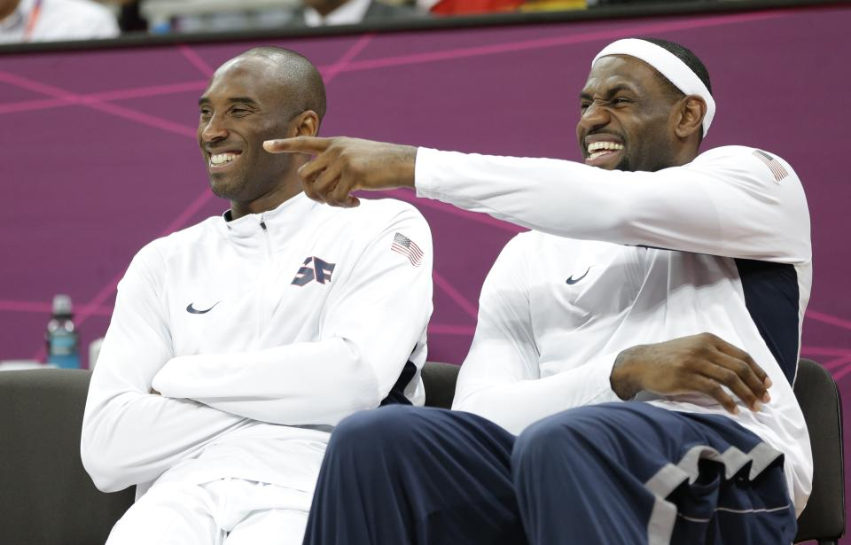 USA's Lebron James, right, and Kobe Bryant react during the second half of a preliminary men's basketball game against France at the 2012 Summer Olympics, Sunday, July 29, 2012, in London. (AP Photo/Eric Gay)