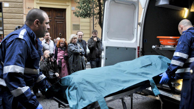 """The body of Italian filmmaker Carlo Lizzani is carried on a stretcher by paramedics in downtrown Rome, Saturday, Oct. 5, 2013. Lizzani, a protagonist of Italian Neorealism, has died at age 91. Lizzani died after a fall from the third-floor balcony of his home in Rome, and that authorities were investigating whether it was a suicide. Lizzani started out as a film critic, then as a writer on such seminal films as Roberto Rossellini's 1948 """"Germany Year Zero"""" and Giuseppe De Santis' 1950 film """"Bitter Rice,"""" which earned him an Oscar nomination. The Academy of Italian Cinema awarded him best director for his 1968 film """"The Violent Four,"""" and best screenwriter for the 1996 film """"Celluloide."""" (AP Photo/LaPresse)"""