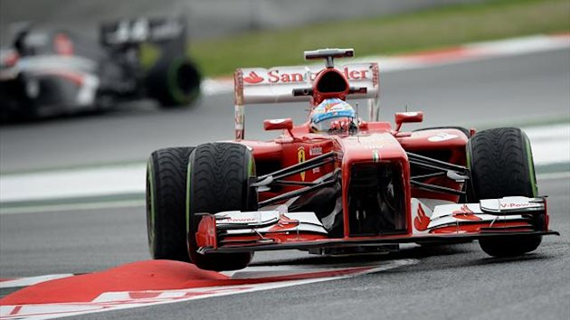 Ferrari's Spanish driver Fernando Alonso drives during the first practice session at the Circuit de Catalunya in Montmelo near Barcelona (AFP)