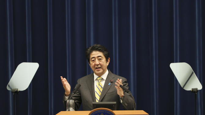 Japanese Prime Minister Shinzo Abe speaks during a press conference at his official residence in Tokyo, Tuesday, June 24, 2014. Abe formally announced an outline of his long-awaited growth strategy, a slew of reforms meant to revitalize the economy and restore its global competitiveness. The plan, approved by the Cabinet earlier in the day, includes dozens of proposed changes to labor regulations, government pension fund investments, corporate governance and tax policies that Abe says are needed to spur corporate investment and innovation. (AP Photo/Koji Sasahara)