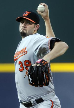 Baltimore Orioles pitcher Jason Hammel works the mound against the Atlanta Braves during the first inning of a baseball game on Saturday, June 16, 2012, in Atlanta. (AP Photo/John Amis)