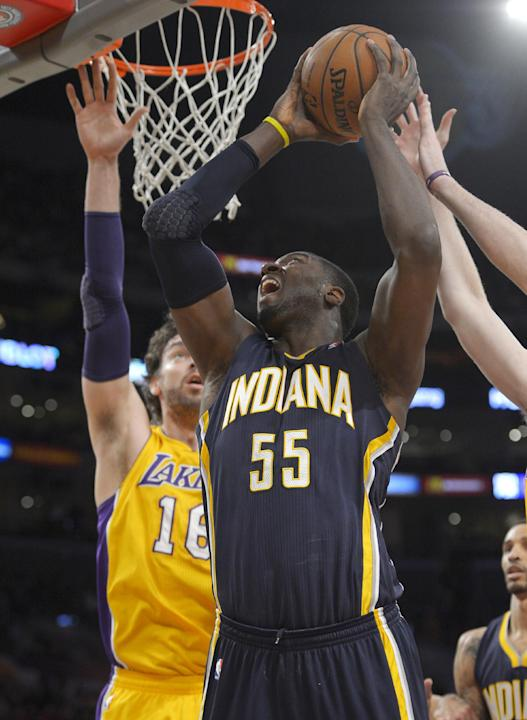 Indiana Pacers center Roy Hibbert, right, puts up a shot as Los Angeles Lakers center Pau Gasol, of Spain, defends during the first half of an NBA basketball game, Tuesday, Jan. 28, 2014, in Los Angel
