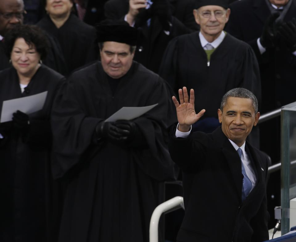 President Barack Obama waves after his  ceremonial swearing-in at the U.S. Capitol during the 57th Presidential Inauguration in Washington, Monday, Jan. 21, 2013. (AP Photo/Paul Sancya)