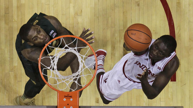 Indiana's Victor Oladipo, right, shoots against Michigan State's Branden Dawson during the second half of an NCAA college basketball game on Sunday, Jan. 27, 2013, in Bloomington, Ind. Indiana defeated Michigan State 75-70. (AP Photo/Darron Cummings)