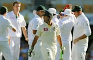 Australian batsman Ricky Ponting (C) looks back as he leaves the field after being dismissed for no runs by South African bowler Morne Morkel (2nd-L). Senior batsman Ponting lasted just five balls before he edged Morkel to the safe hands of Kallis for a duck to leave the home side wobbling at 40 for three