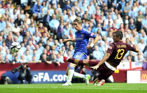 Chelsea striker Fernando Torres scores the opening goal during Community Shield against Manchester City at Villa Park
