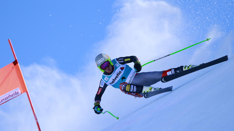 Ted Ligety of the United States, speeds on his way to take second place in a men's alpine skiing downhill at the World Cup finals in Lenzerheide, Switzerland, Wednesday, March 12, 2013. (AP Photo/Shinichiro Tanaka)