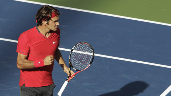 Roger Federer of Switzerland reacts during a semifinal match against Novak Djokovic of Serbia at the U.S. Open tennis tournament in New York, Saturday, Sept. 10, 2011. (AP Photo/Charlie Riedel)