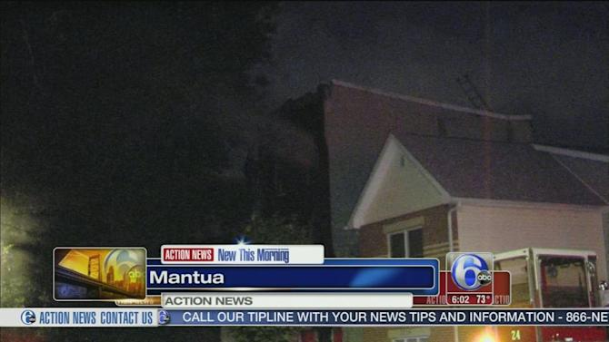 Officers rescue 2 from burning Mantua home