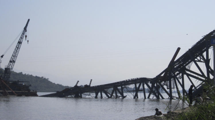 A bridge under construction across the Irrawaddy River, east of Shwebo, Myanmar is seen collapsed after a strong earthquake on Sunday, Nov. 11, 2012. The magnitude-6.8 quake struck northern Myanmar on Sunday, collapsing the bridge and a gold mine, damaging several old Buddhist pagodas and leaving as many as 12 people feared dead. The bridge links the town of Sintku, 65 kilometers (40 miles) north of Mandalay on the east bank of the Irrwaddy with Kyaukmyaung on the west bank. (AP Photo/Weekly Eleven News) MANDATORY CREDIT