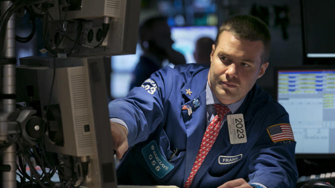 FILE - In this Wednesday, Oct. 30, 2013, file photo, specialist Frank Masiello works at his post on the floor of the New York Stock Exchange. (AP Photo/Richard Drew, File)