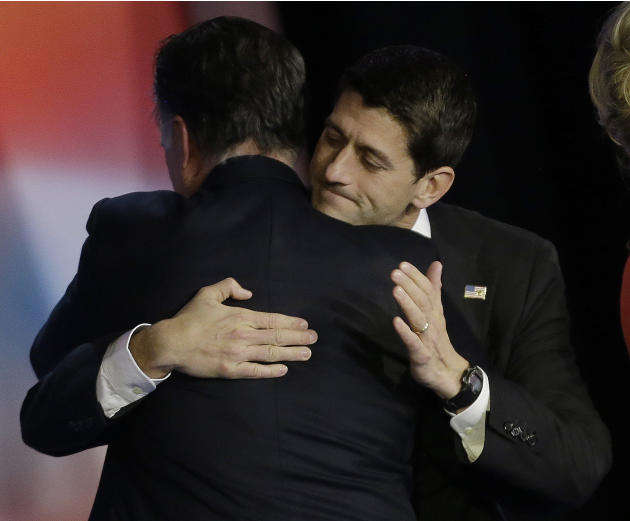Republican presidential candidate and former Massachusetts Gov. Mitt Romney embraces Republican vice presidential candidate, Rep. Paul Ryan, R-Wis., after Romney conceded the race during his election