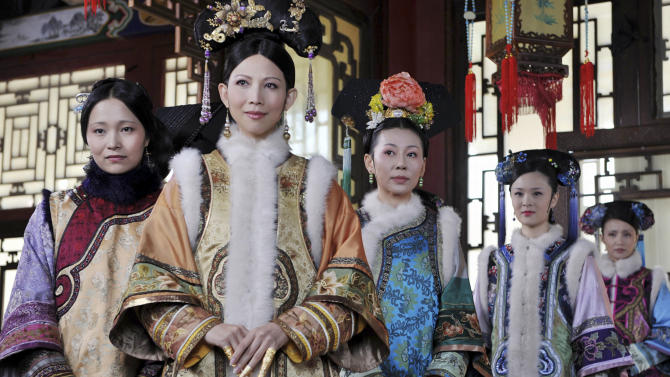 "This undated photo released by Videoland Cable Network Taiwan shows Chinese actress Sun Li, second from left, in costume with her supporting actresses on set of the TV series ""The Legend of Zhen Huan"" in mainland China. Set in the imperial palace of the Qing dynasty in the 17th century ""The Legend of Zhen Huan"" is a TV drama series written by a 28-year-old Chinese online fiction writer that has captivated viewers in Taiwan, but its emphasis on the dark side of human nature has made it less popular with cultural authorities in China. (AP Photo/Videoland Cable Network) EDITORIAL USE ONLY"