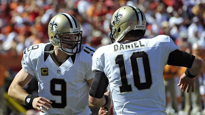 New Orleans Saints quarterback Drew Brees (9) celebrates with backup quarterback Chase Daniel (10) after throwing a touchdown pass to tight end David Thomas against the Tampa Bay Buccaneers during the second quarter of an NFL football game on Sunday, Oct. 21, 2012, in Tampa, Fla. (AP Photo/Brian Blanco)