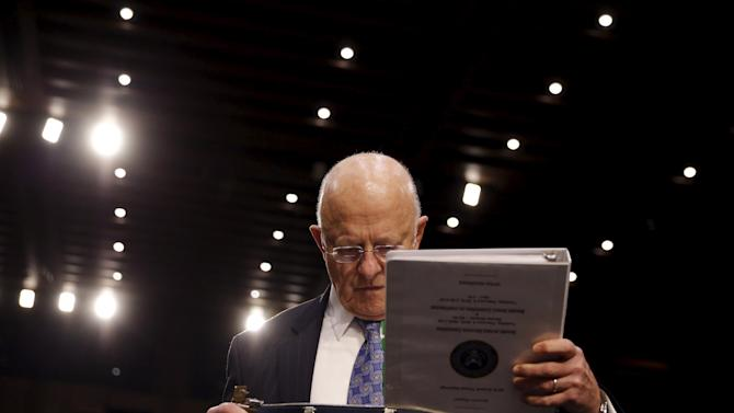 """Director of National Intelligence (DNI) James Clapper arrives to testify before a Senate Intelligence Committee hearing on """"Worldwide threats to America and our allies"""" in Capitol Hill, Washington"""
