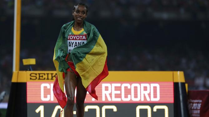 Ayana of Ehtiopia reacts after winning the women's 5000m event during the 15th IAAF World Championships at the National Stadium in Beijing