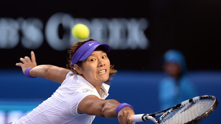 China's Li Na reaches for a return to Victoria Azarenka of Belarus during the women's final at the Australian Open tennis championship in Melbourne, Australia, Saturday, Jan. 26, 2013. (AP Photo/Andrew Brownbill)