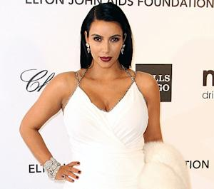 "Kim Kardashian Raves About ""Perfect"" Maternity Jeans in First ""Mommy Blog"" Post"