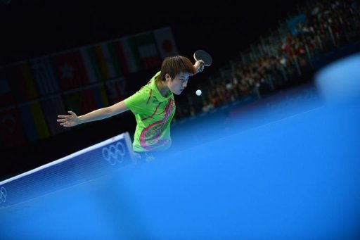 China's Ding Ning serves to Singapore's Feng Tianwei