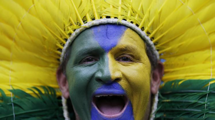 A Brazil supporter poses with his face paint before the World Cup semifinal soccer match between Brazil and Germany at the Mineirao Stadium in Belo Horizonte, Brazil, Tuesday, July 8, 2014. (AP Photo/Natacha Pisarenko)