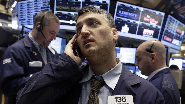 FILE - In this Wednesday, Feb. 5, 2014, file photo, trader Nicholas DeStafano, center, works on the floor of the New York Stock Exchange. Global stock markets were higher Friday Feb. 7, 2014 in anticipation of a positive U.S. jobs report for January. (AP Photo/Richard Drew, File)