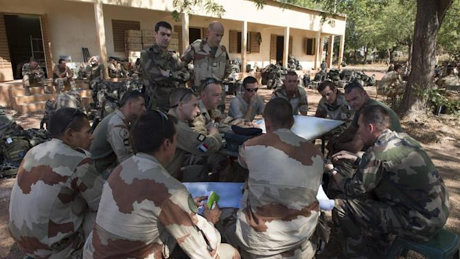 "In this picture released by the French Army Communication Audiovisual office (ECPAD) French army officers attend a briefing at an undisclosed location, north of the Malian capital, Bamako, Wednesday, Jan. 16, 2013. French troops pressed northward in Mali toward territory occupied by radical Islamists on Wednesday, military officials said, announcing the start of a land assault that will put soldiers in direct combat ""within hours."" (AP Photo/Arnaud Roine, ECPAD)"